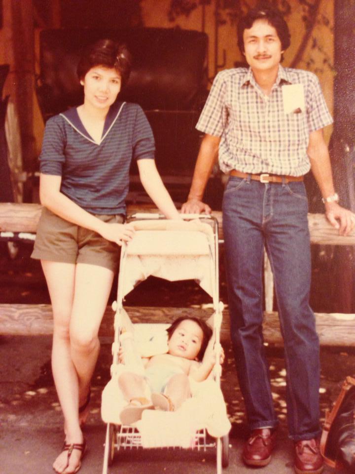 a picture of my mom, my dad, and me when I was a little boy